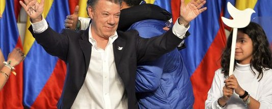 President Juan Manuel Santos celebrates his victory in the presidential runoff at his campaign headquarters in Bogota, Colombia, on Sunday. Santos defeated challenger Oscar Ivan Zuluaga, of the Democratic Center, and won a second four-year term. (Photo: AP Photo/Santiago Cortez)