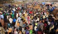 Displaced people walk around Tomping camp in Juba