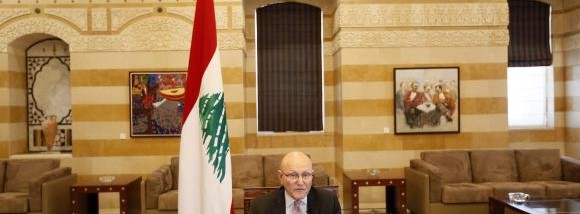 Lebanon's Prime Minister Tammam Salam speaks during an interview with Reuters in his office in Beirut
