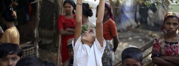 Rohingya children play at Thae Chaung refugee camp outside Sittwe