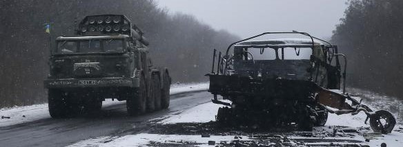 Ukrainian armed forces ride on a multiple rocket launcher system near Debaltseve