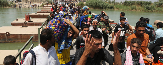 Iraqi civilians fleeing fighting in Ramadi crossed the Bzebiz Bridge, which offers passage into Baghdad from Anbar Province. Credit Karim Kadim/Associated Press