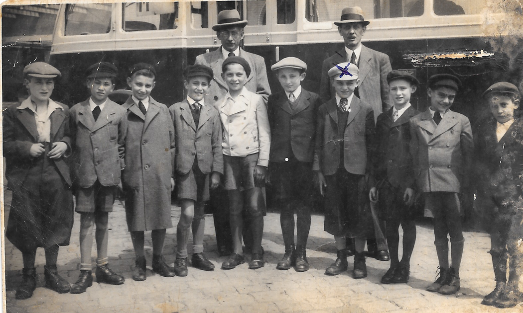 Image: Ernst Steiner, fourth from the right, in Bratislava in 1939, shortly before his train journey to England. CreditAmit Yahav